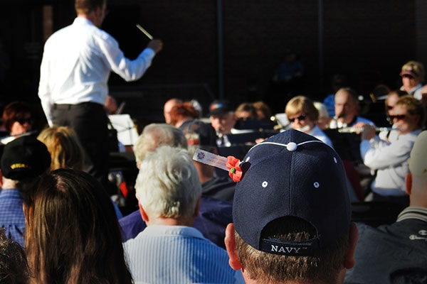 Red River Valley Veterans Concert Band director performing and Navy hat